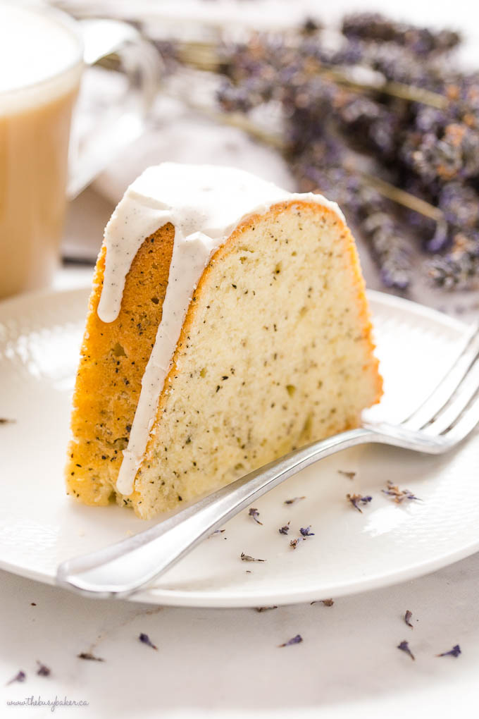 closeup image: slice of earl grey bundt cake on white plate with fork