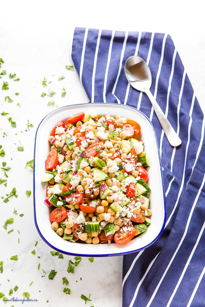 Greek Chickpea Salad in white enamel bowl with blue rim