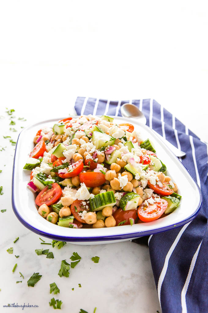 Greek Chickpea Salad in white enamel bowl