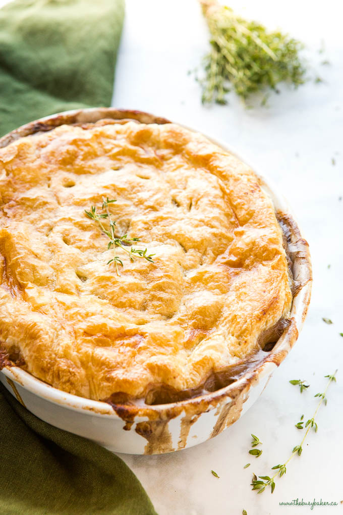 vegetarian mushroom pot pie in white baking dish with fresh thyme