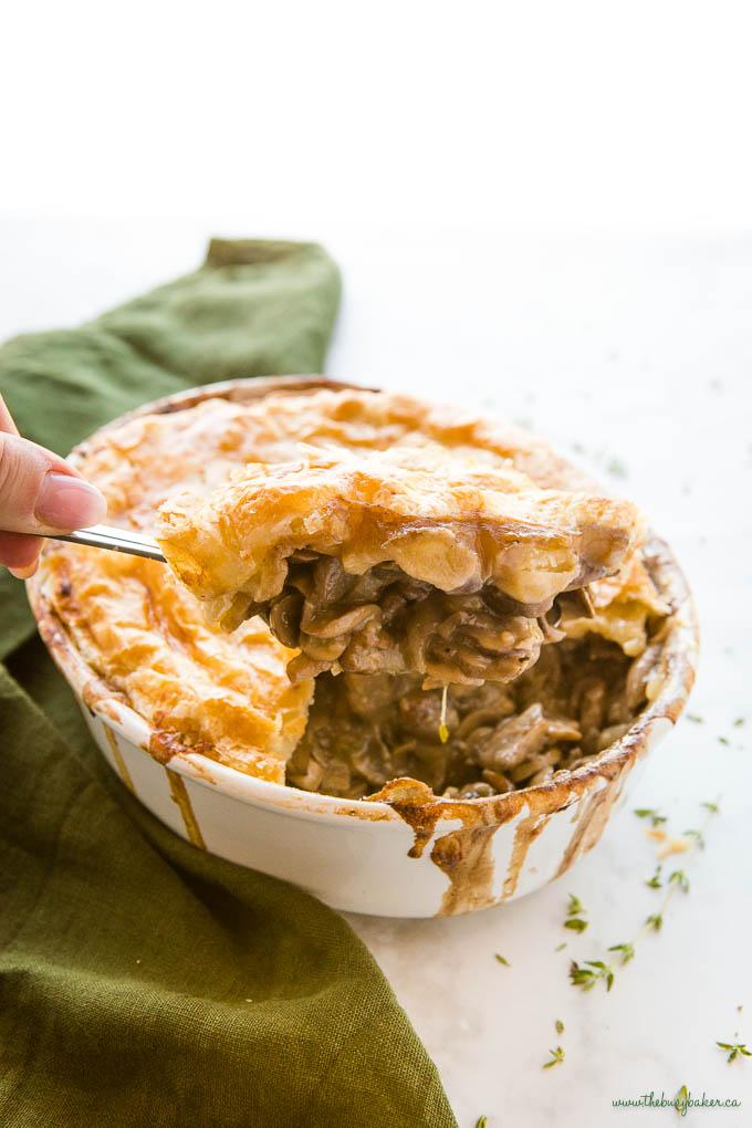 hand serving vegetarian mushroom pot pie