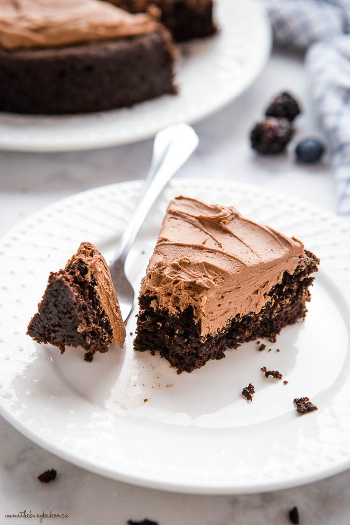 bite of chocolate cake with chocolate frosting on fork