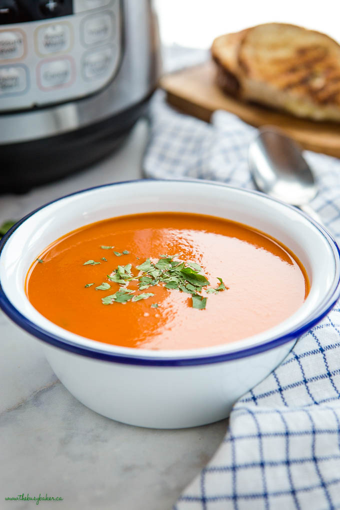 tomato soup in white bowl with blue rim