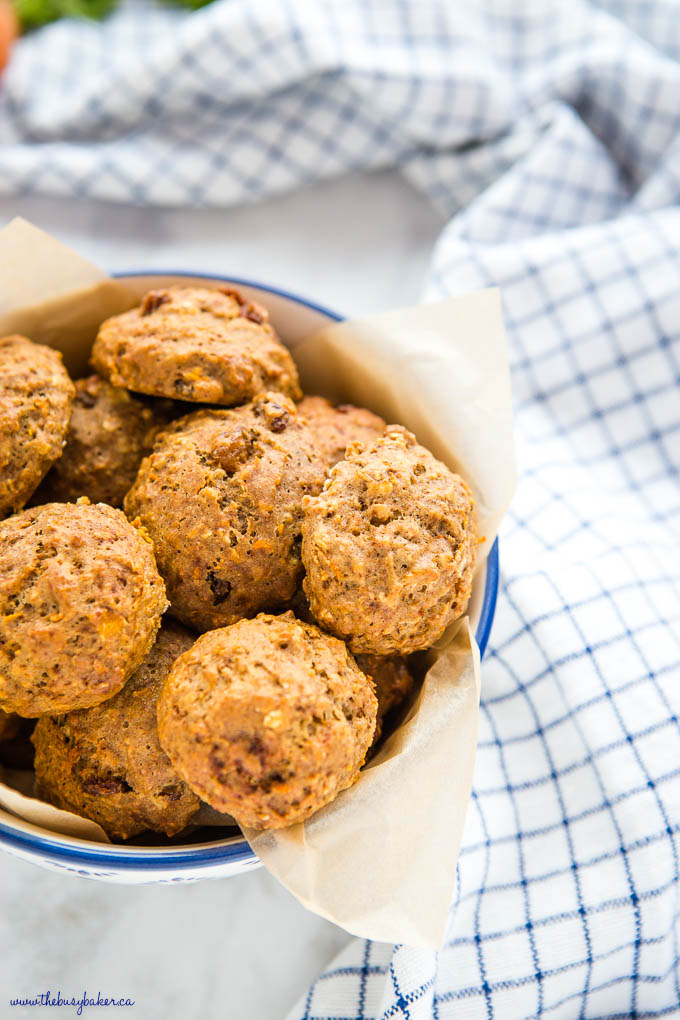 healthy carrot cake oatmeal cookies in white bowl with blue rim