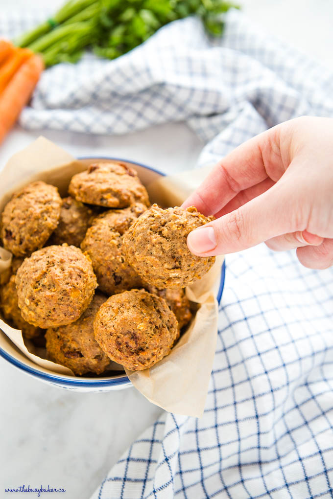 hand reaching for a healthy carrot cake cookie