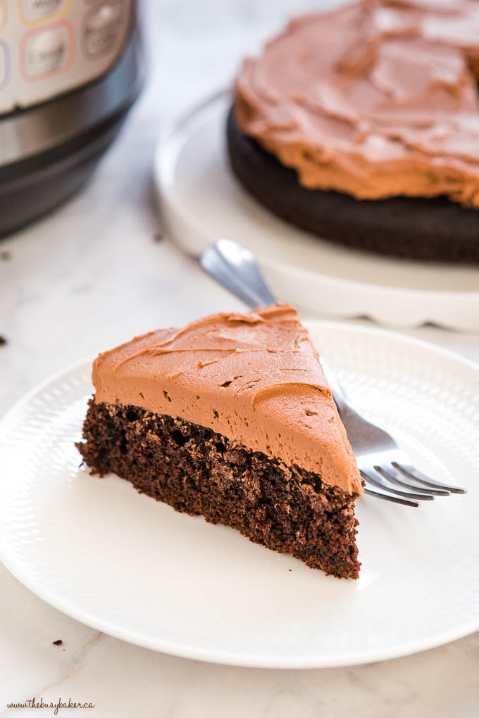 slice of chocolate cake with chocolate frosting on a white plate