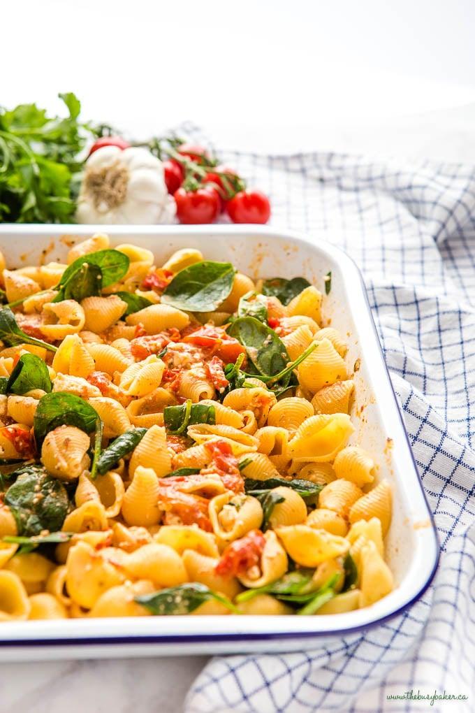 easy baked feta pasta in white baking pan with blue rim