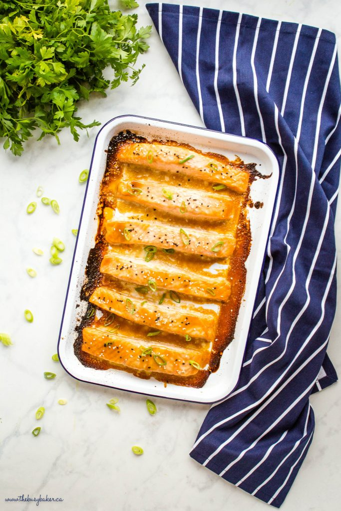 overhead image: miso salmon on white baking tray