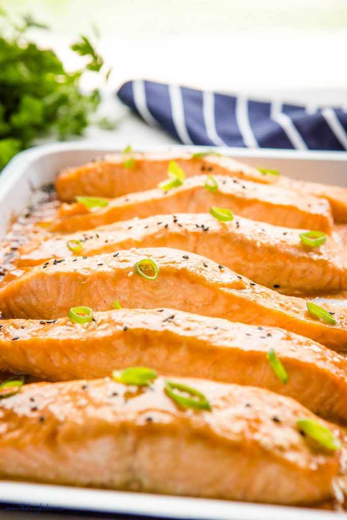 miso salmon on baking sheet with sesame seeds and green onions