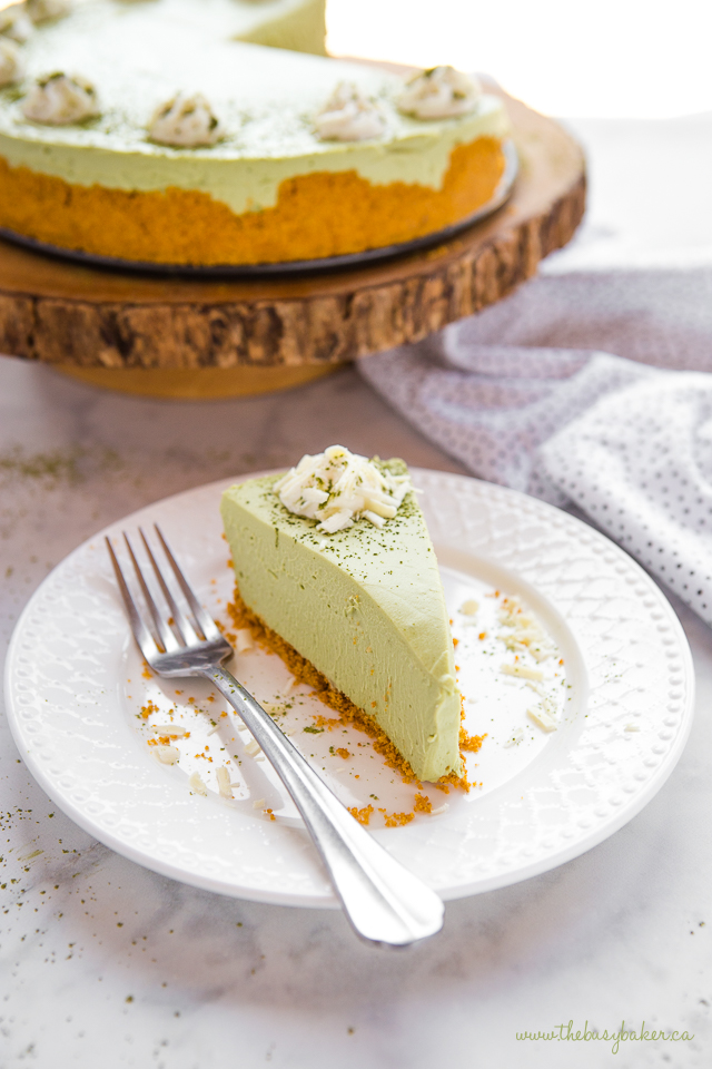 slice of matcha cheesecake on white plate with fork