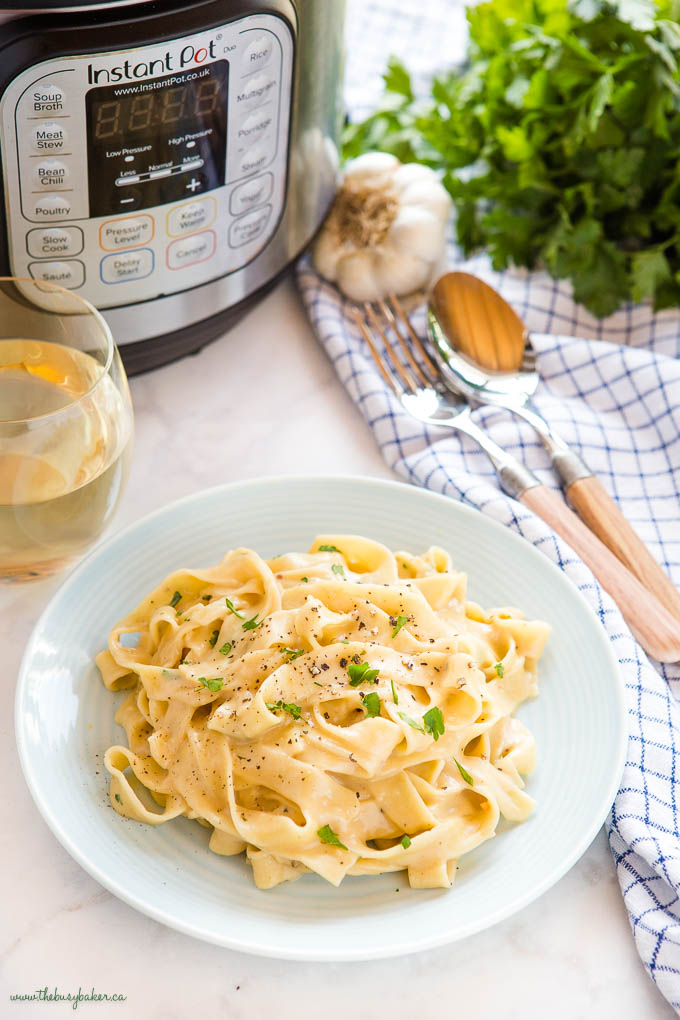 plate of Instant Pot Fettuccine Alfredo with white wine