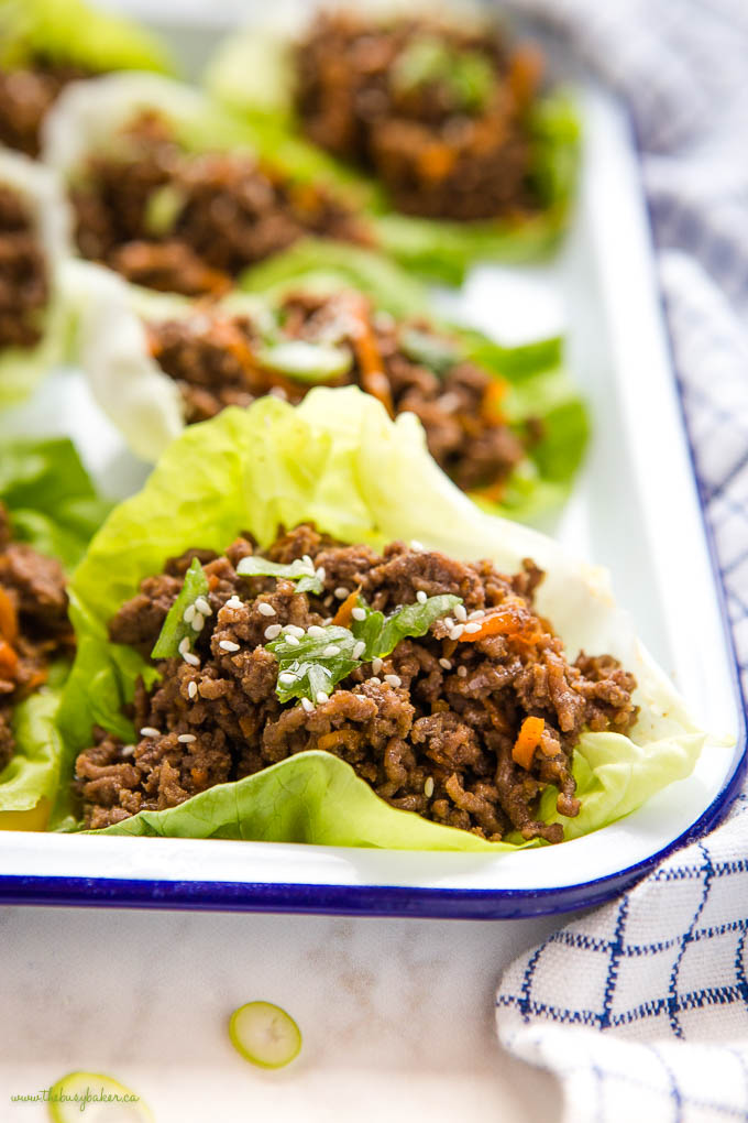 closeup image: low carb beef lettuce wrap with carrots and green onions
