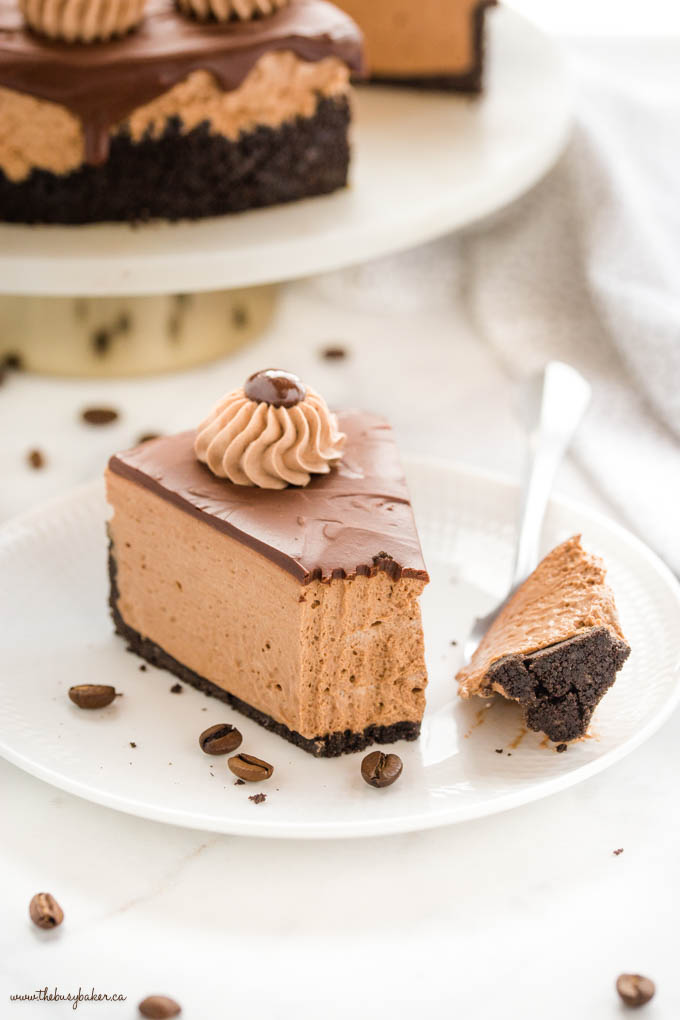 slice of coffee cheesecake with a bite on a fork