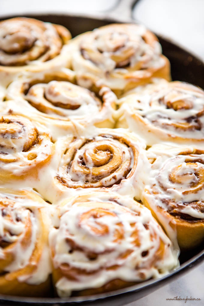 closeup image: one-hour cinnamon rolls with cream cheese frosting