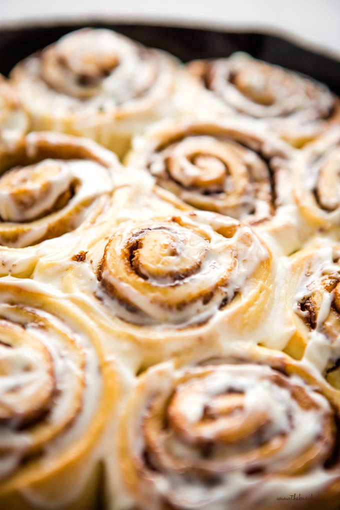 closeup image: easy cinnamon rolls with cream cheese frosting
