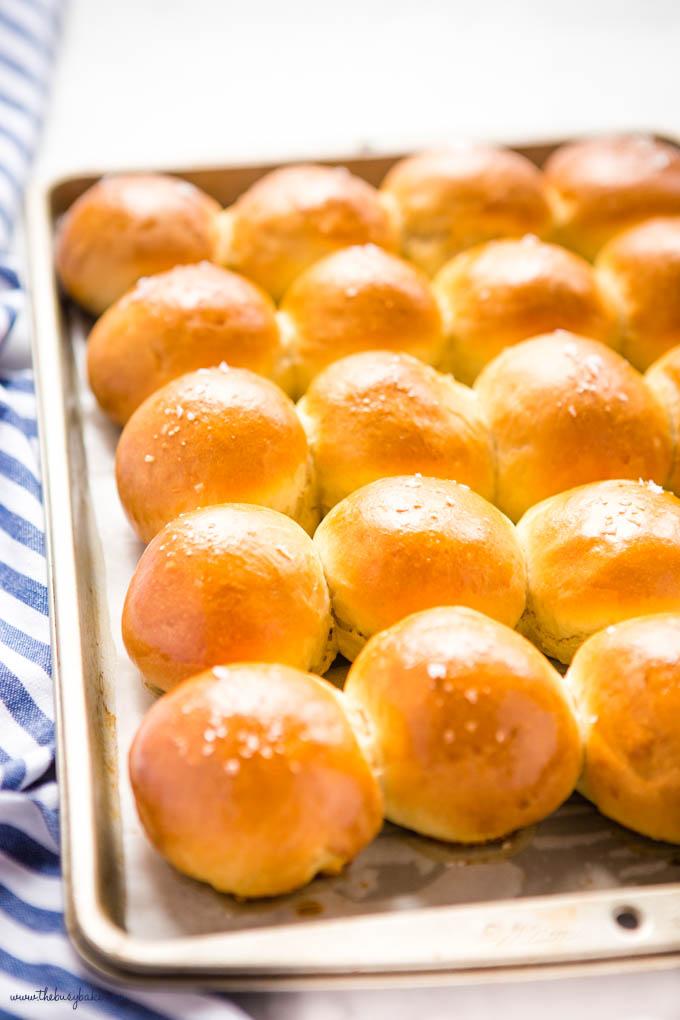 golden brown dinner rolls on baking tray