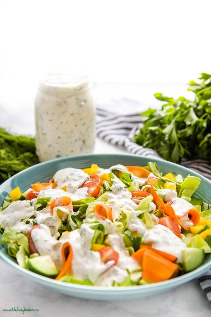 salad with ranch dressing in a blue bowl