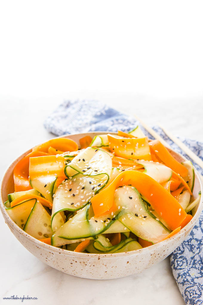 asian salad with carrots and cucumbers in a ceramic bowl