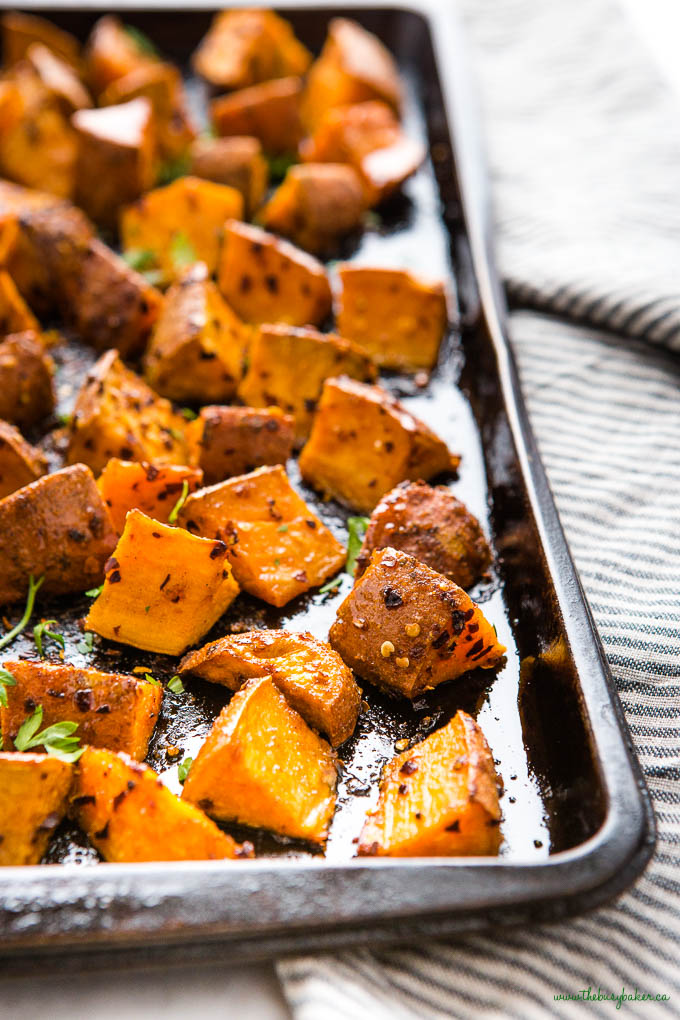 closeup image: roasted sweet potatoes with chili flakes, honey and paprika