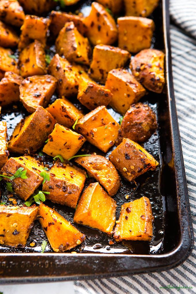 sweet potatoes on sheet pan with chili flakes and honey
