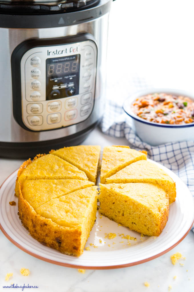 plate of cornbread with a bowl of chili