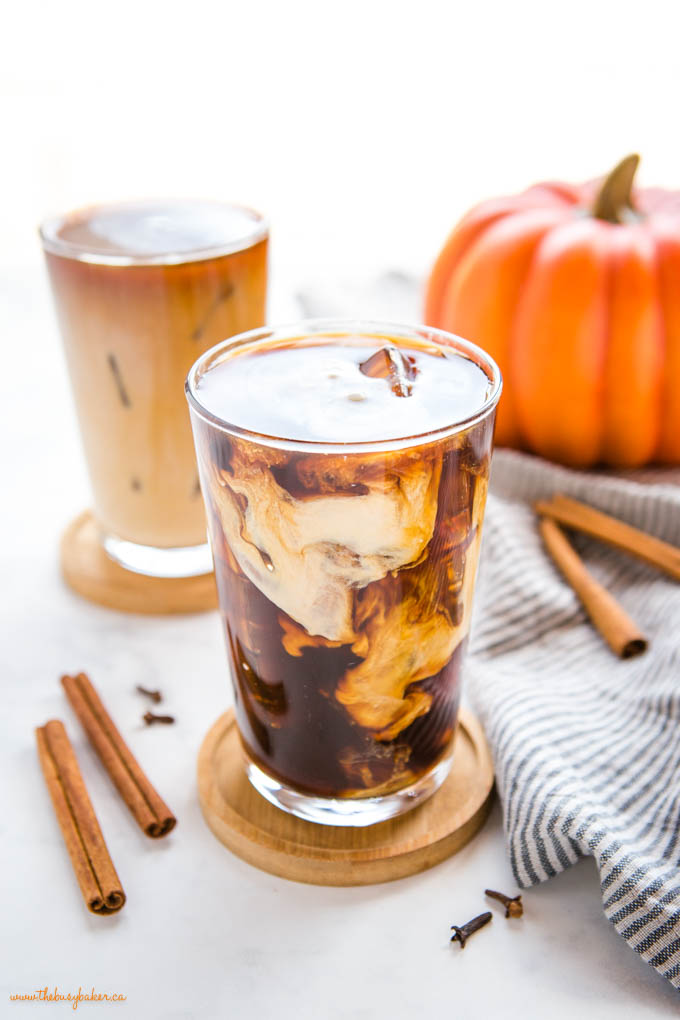 starbucks pumpkin cream cold brew coffee in tall glass with ice