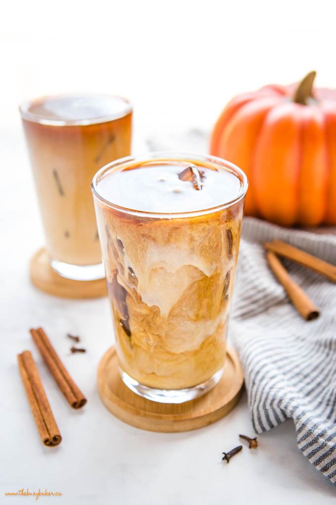 swirls of pumpkin cream in cold brew coffee