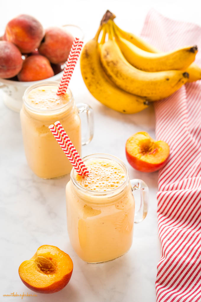 post workout banana peach smoothie in glass cup