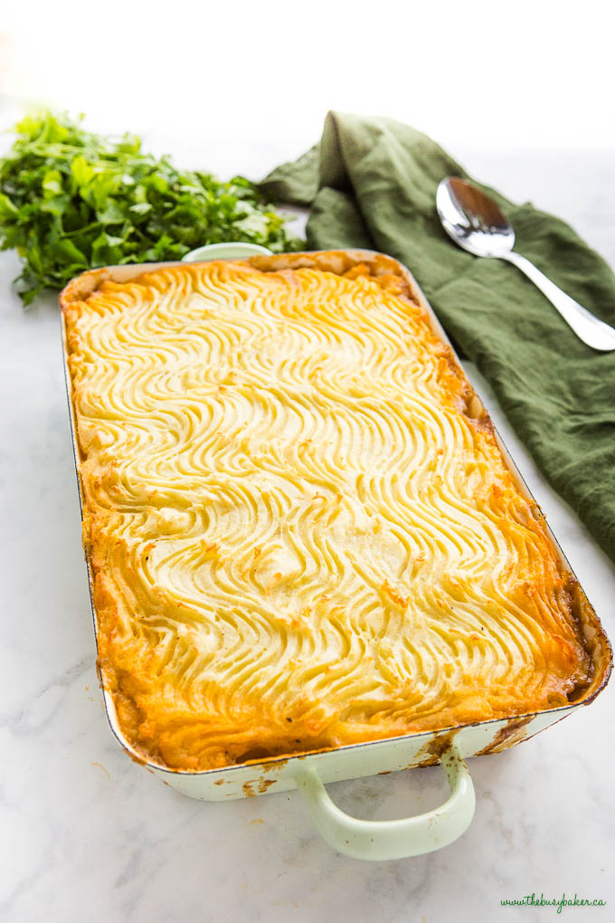 green pan with cottage pie, topped with crispy mashed potatoes