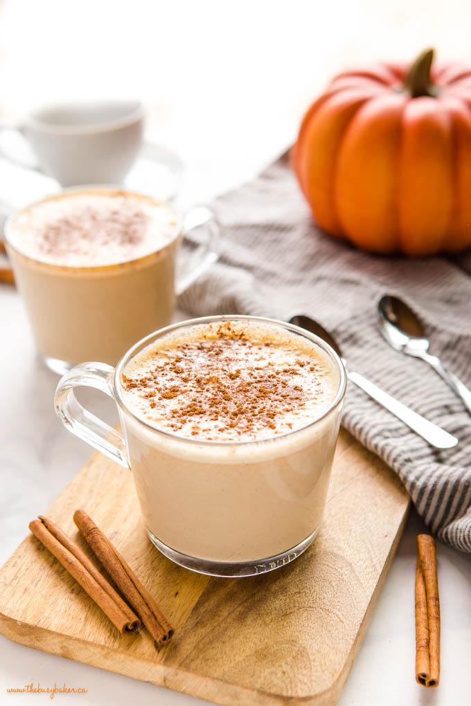 pumpkin spice latte in glass mug with cinnamon