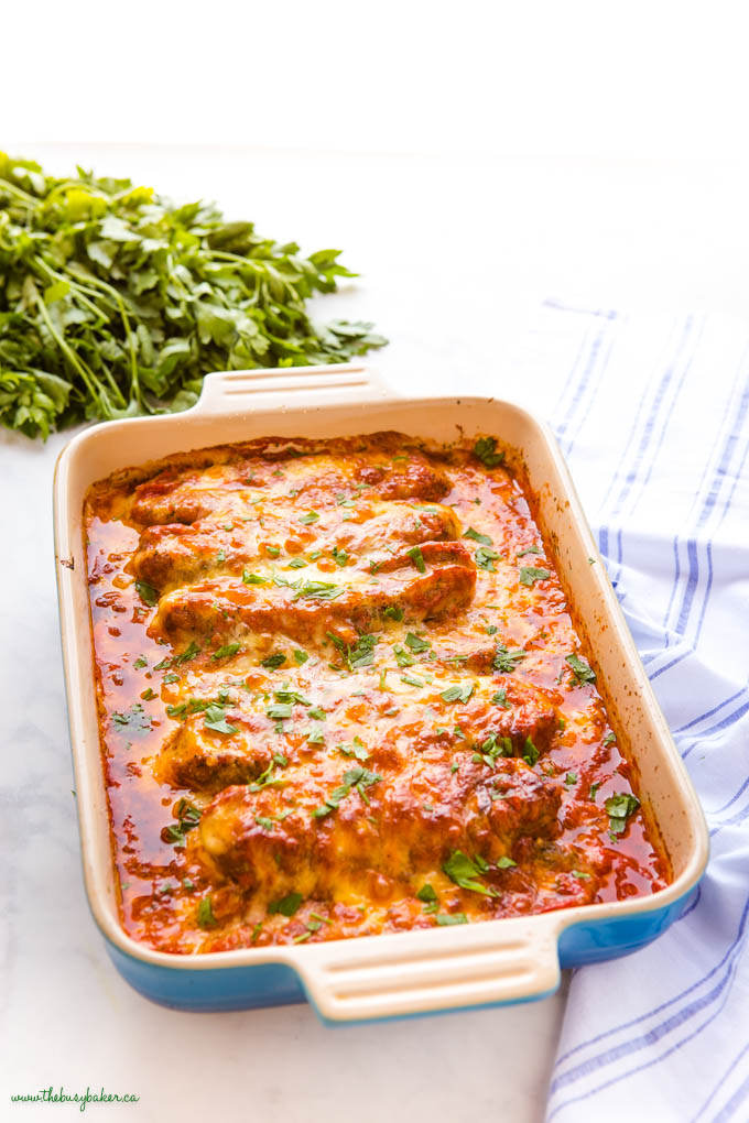 stuffed sausages baked in marinara sauce with cheese and fresh herbs