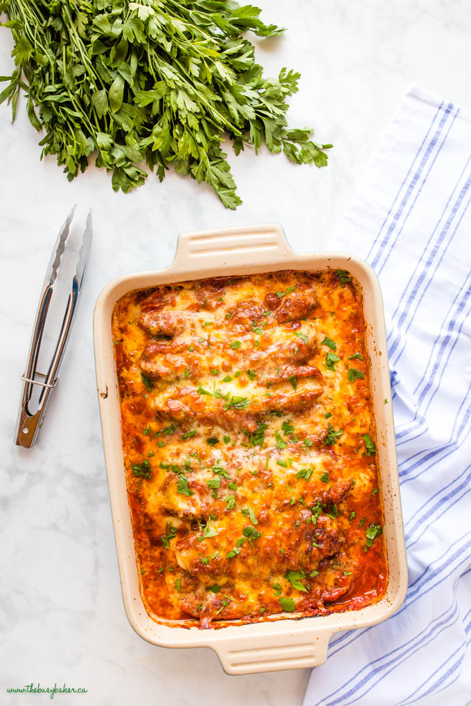 overhead image: stuffed sausages baked in marinara sauce with cheese